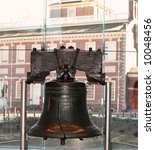 Liberty Bell with Independence Hall in background - stock photo
