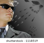 man in suit with handprint surrounding him - stock photo