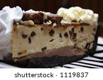 Slice of a chocolate peanut butter pie with whipped cream and ice cream - stock photo