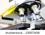 Microscope in lab, low DOF, close-up - stock photo