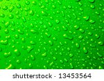 waterdrops on green background from above - stock photo
