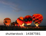 Evening hot air balloon glow at the Dallas Fort Worth (DFW) Summer Balloon Classic held in Waxahachie, Texas on June 21, 2008.  Editorial use only. - stock photo