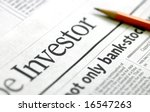 Investor - Business newspapers and market analysis - stock photo