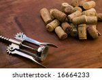 wine corks over wood table - stock photo