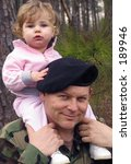 american army soldier with baby on his shoulders - stock photo