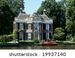 Old historical building at the river the Vecht in the Netherlands - stock photo