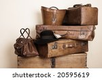 Collection of leather suitcases with a black suede hat - stock photo