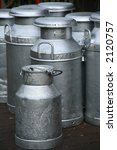 old fashioned milk churns - stock photo