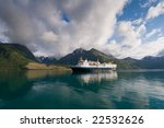 Cruise ship on glacial water of Norwegian fjord - stock photo