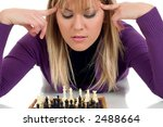 Girl playing chess with you - stock photo