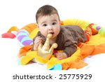 Photo of adorable baby newborn in pink clothes on children's carpet - stock photo