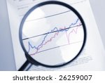 observe curve chart  through  magnifier - stock photo