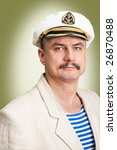 Professional captain with white hat - stock photo