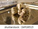 truffles, very expensive mushrooms, on gold plate - stock photo
