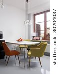 modern dining room with oldschool chairs - stock photo