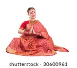 Beautiful young girl with Indian red sari - stock photo