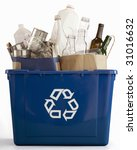 Recycle bin filled with recyclables - stock photo
