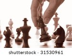 Chess game black queen advances sepia tone - stock photo