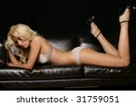 Lingerie Model on Couch - stock photo