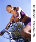 Woman on bicycle - stock photo