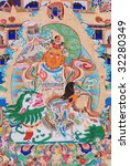 "antique ""Thangka"": is a painted or embroidered Buddhist banner which was hung in a monastery or a family altar and carried by lamas in ceremonial processions. - stock photo"