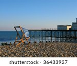 A deckchair on the beach at Bognor Regis Sussex England - stock photo