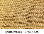 Burlap background. Focused on the right side of cloth. - stock photo