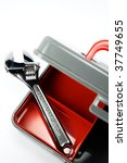 Adjustable Wrench in a New Red Tool Box Isolated on White - stock photo