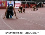 TARTU, ESTONIA - MAY 20: Runners get ready on the track at Student Sell Games organized by  Estonian Academic Sports Federation May 20, 2006 in Tartu, Estonia. - stock photo