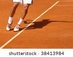 Feet of a tennis player in service motion - stock photo
