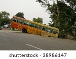 AGRA - JUNE 18: Bus accident. Indian traffic while chaotic is still quite safe. Bad roads equal slow driving and very careful drivers. Accidents such as this are rare on June 18, 2007 in Agra, India. - stock photo
