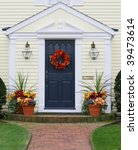 autumn decorated home entrance - stock photo