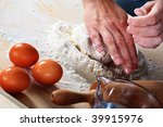 making dough, hands shown slightly moving - stock photo