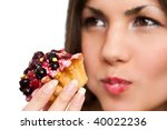 Attractive black hair woman with a cake. Close-up studio portrait isolated on white. - stock photo