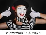 Portrait of a sad mime comedian,on black background - stock photo