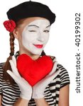 Portrait of a mime, valentine day concept. Isolated over white background - stock photo