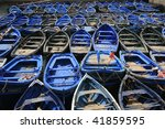 Mix of blue fishing boats in Essaouira port, Morocco - stock photo