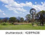 Wind pump on farm - stock photo