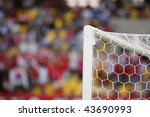 The top corner of a soccer goal in a stadium. - stock photo