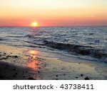Sunset over Nova Scotia beach - stock photo