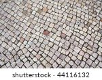 Typical cobblestoned street in Portugal suitable as a background. - stock photo