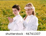 children portrait in first holy communion, praying hands, rite of passage, clear conscience - stock photo