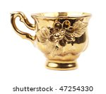 Gold ceramic cup isolated over white - stock photo