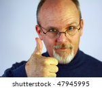 Bald man with glasses and thumb up - stock photo