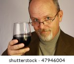 Man with glass of wine - stock photo