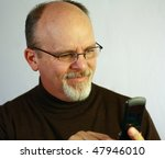Man looking at cell phone - stock photo