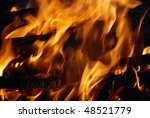 Closeup of burning red fire wood - stock photo