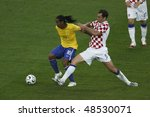 BERLIN - JUNE 13:  Igor Tudor of Croatia (5) defends against Ronaldo of Brazil (10) during a World Cup match June 13, 2006 in Berlin, Germany. Editorial use only.  No pushing to mobile device usage. - stock photo