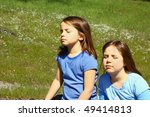 Two girls enjoying the sunshine - stock photo