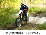 Offroad motorbike crossing river, water splashing. Motion blur. - stock photo